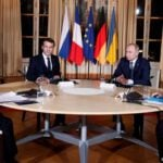 Putin, Zelenskiy meet for Paris summit on Ukraine conflict